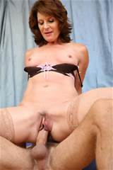 Older cougar in heat bends over to recieve a hard fucking by a big ...
