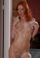 Redhead MILF takes a shower on oiled boobies blog