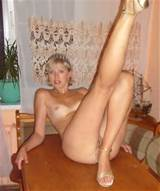 Russian milf at office and home. 14 photos