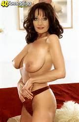 Sexy brunette MILF in red lingerie from 40SomethingMag