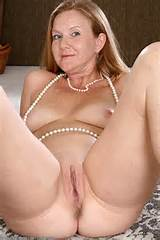 ... redheaded MILF Michelle spreading her long legs from All Over 30