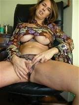 MILF sitting on a chair who moved her panties to the side to finger ...