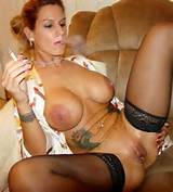 Smoking Tattooed Milf